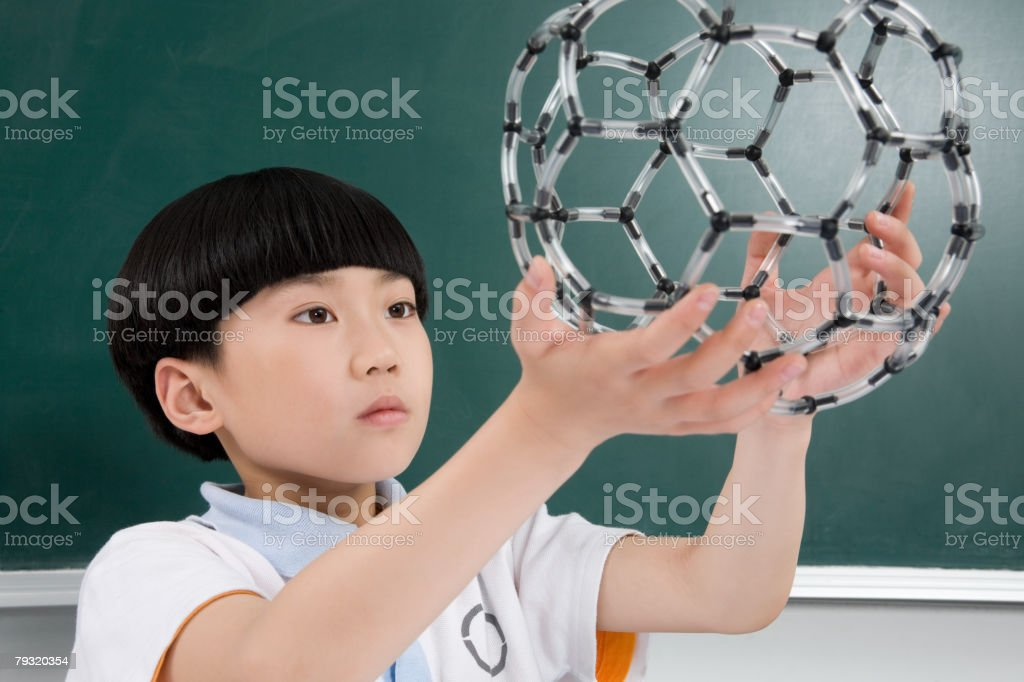 Boy holding a science model royalty-free stock photo