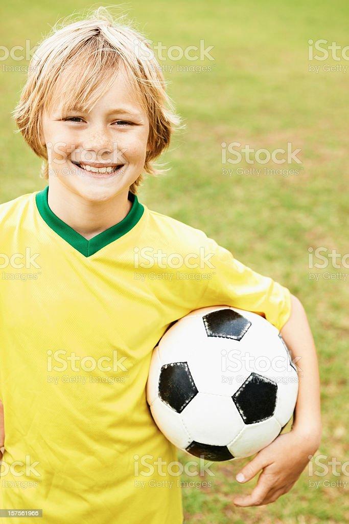 Boy holding a soccer ball royalty-free stock photo
