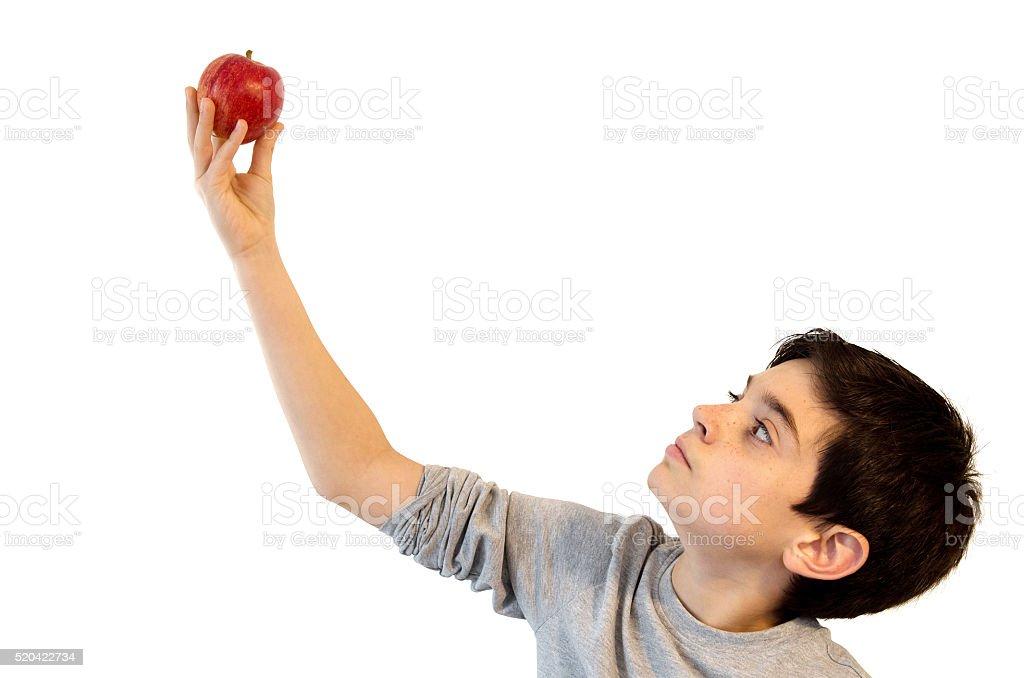 Boy holding an apple royalty-free stock photo