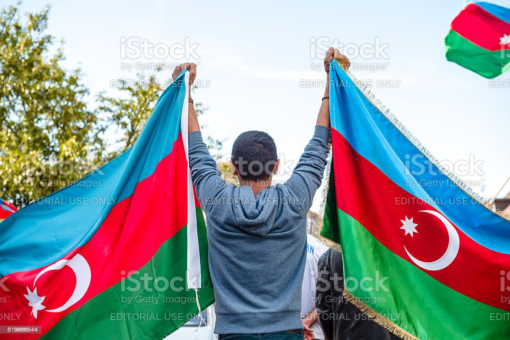 Boy holding Azerbaijan flags in  front of Armenian diaspora stock photo