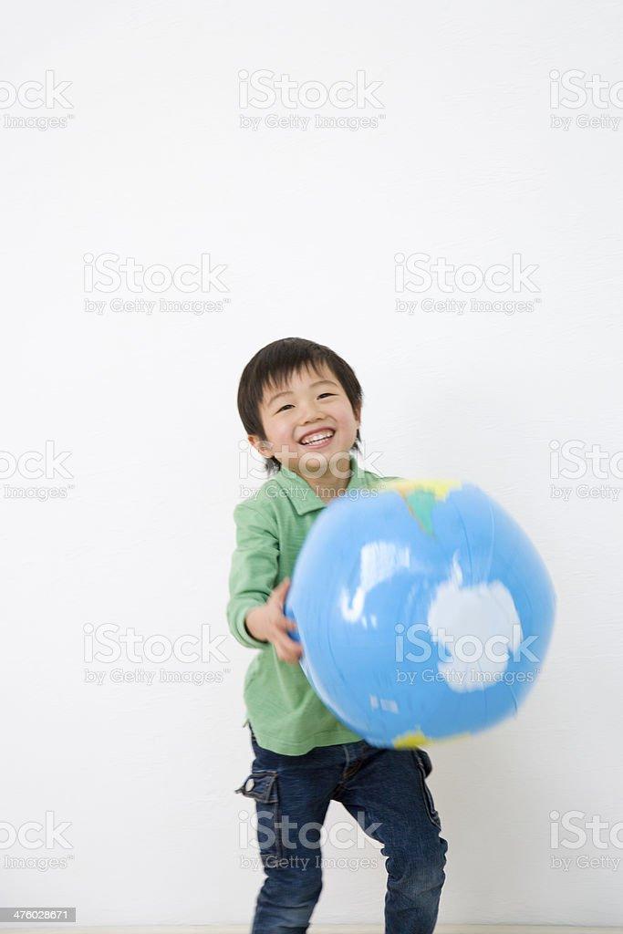 Boy holding ball of earth stock photo