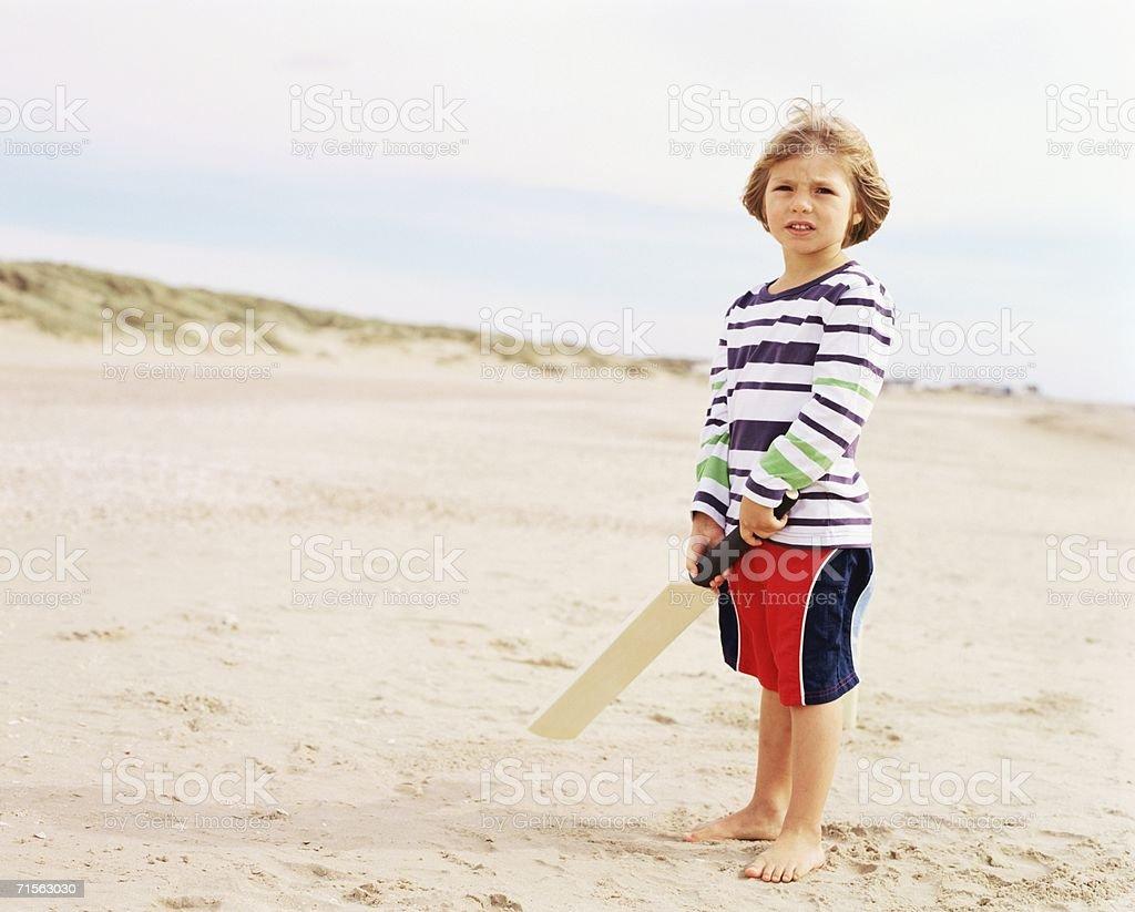 Boy holding bat stock photo
