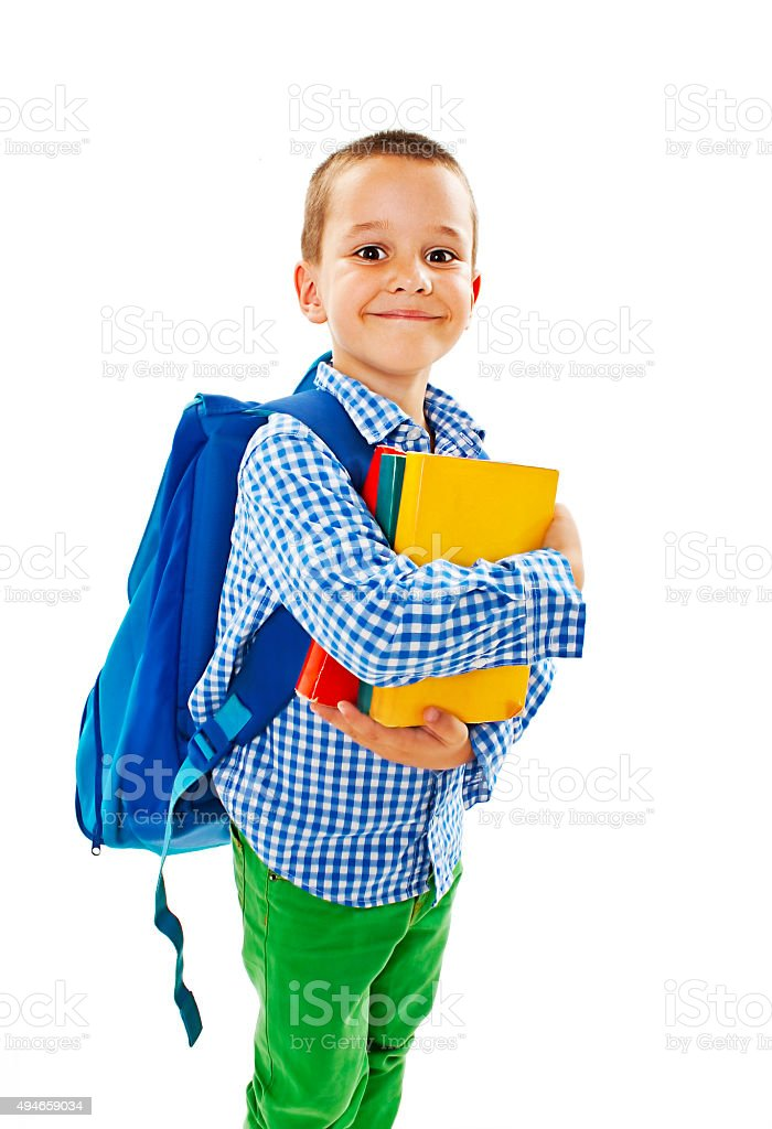 Boy holding books stock photo