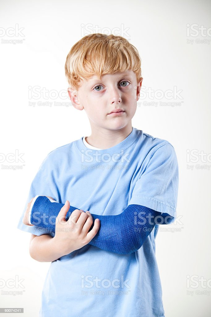 Boy Holding Broken Arm royalty-free stock photo