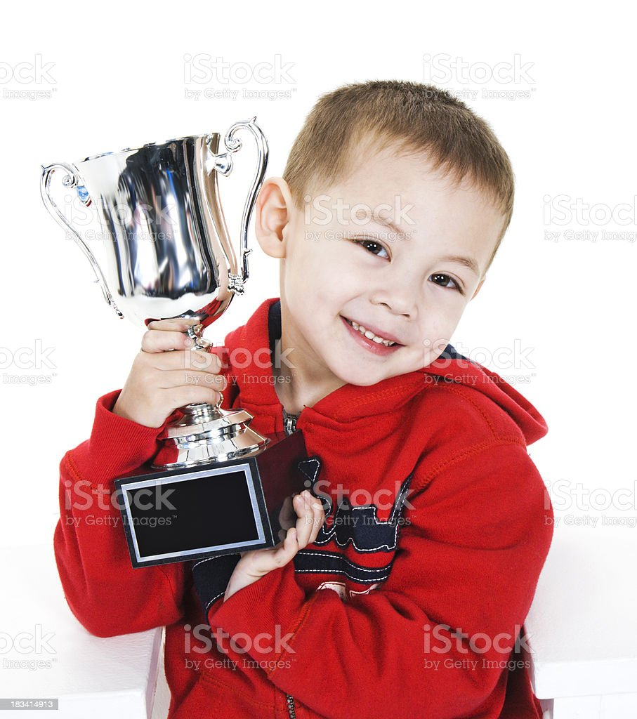 Boy Holding Championship Trophy royalty-free stock photo