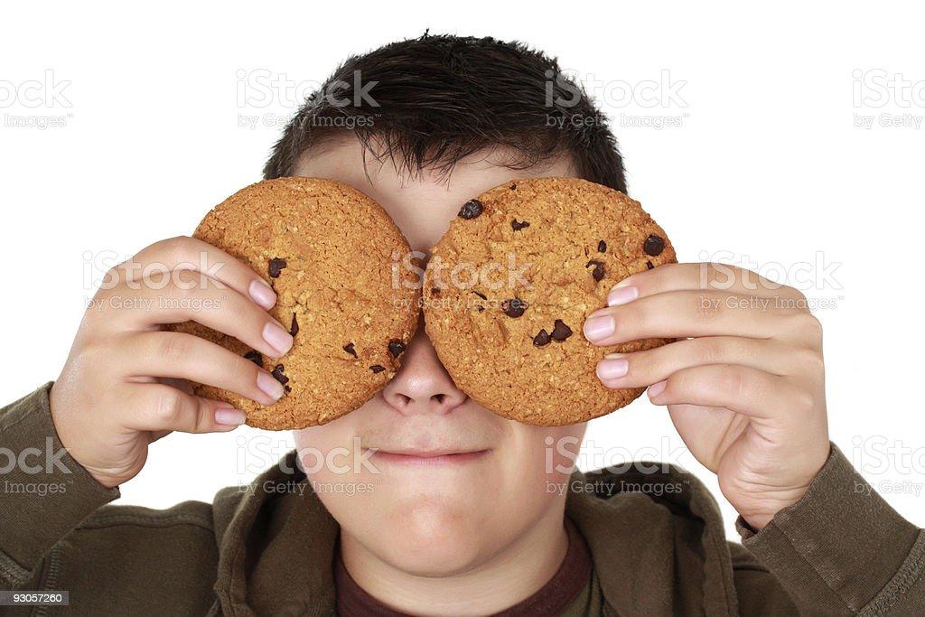 boy holding cookies stock photo