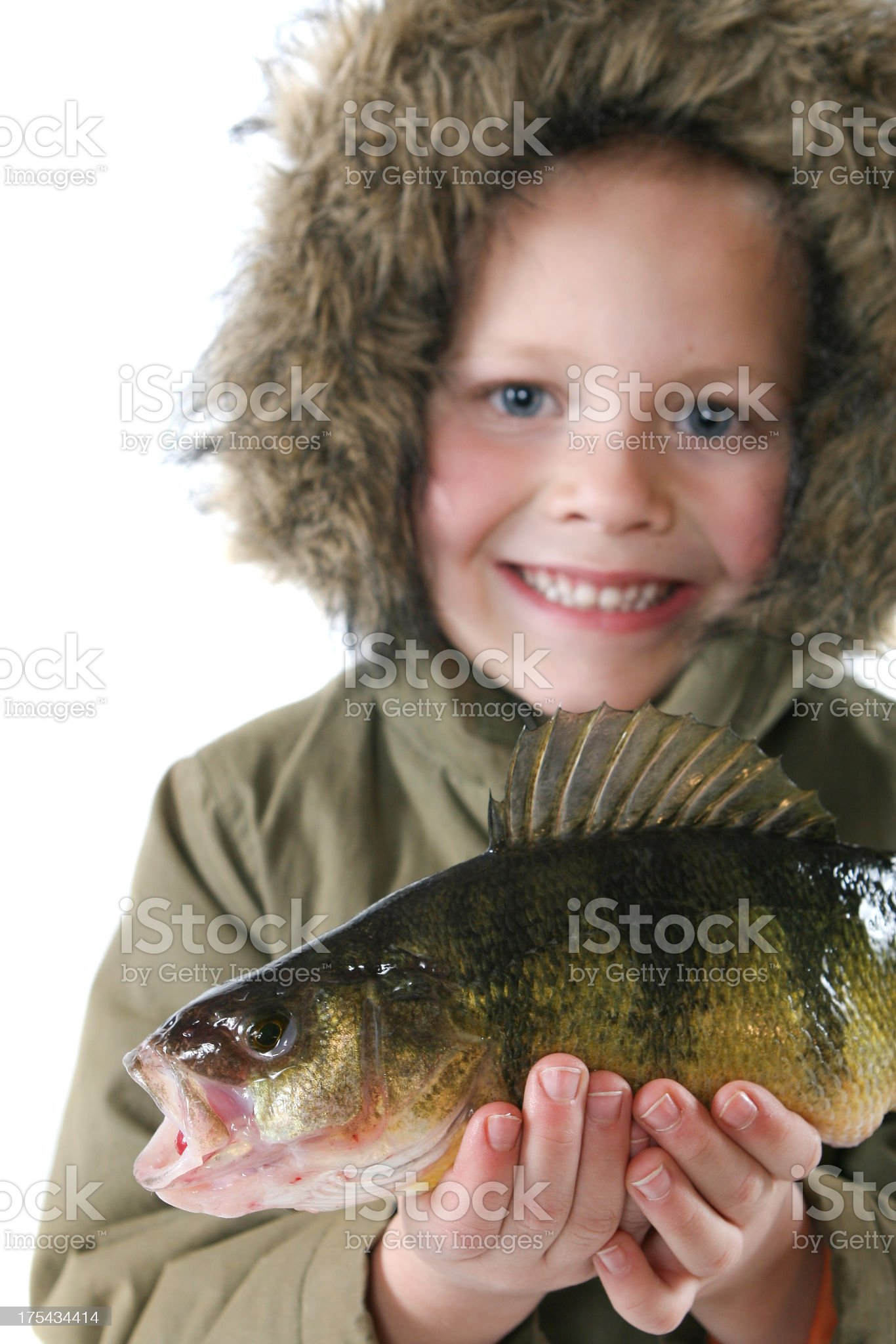 Boy Holding Fish in Winter royalty-free stock photo