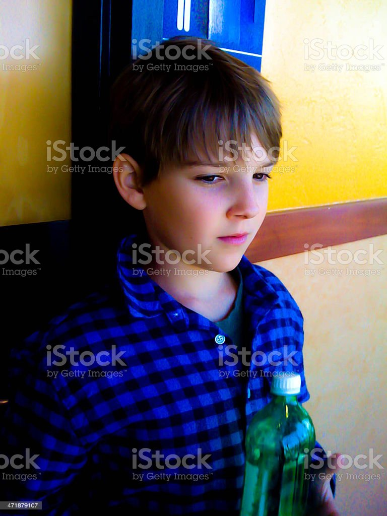 Boy Holding Green Bottle royalty-free stock photo