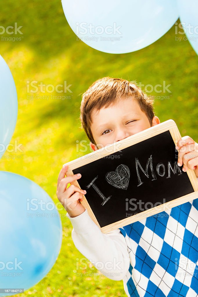 Boy Holding Handwritten Slate royalty-free stock photo
