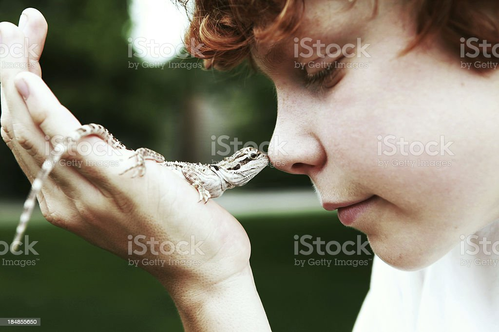 Boy Holding Lizard stock photo