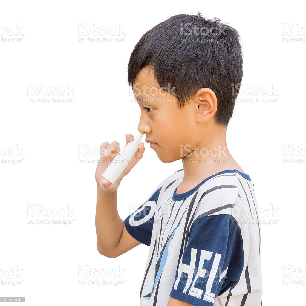 Boy holding nasal spray bottle with clipping path stock photo