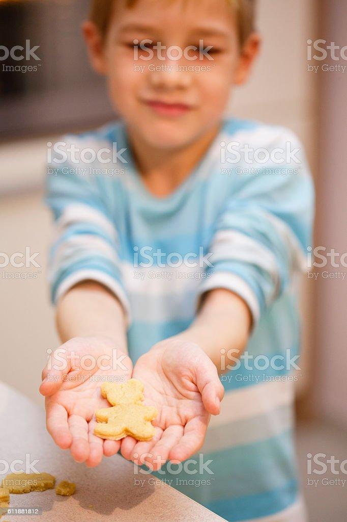 Boy holding piece of dough stock photo