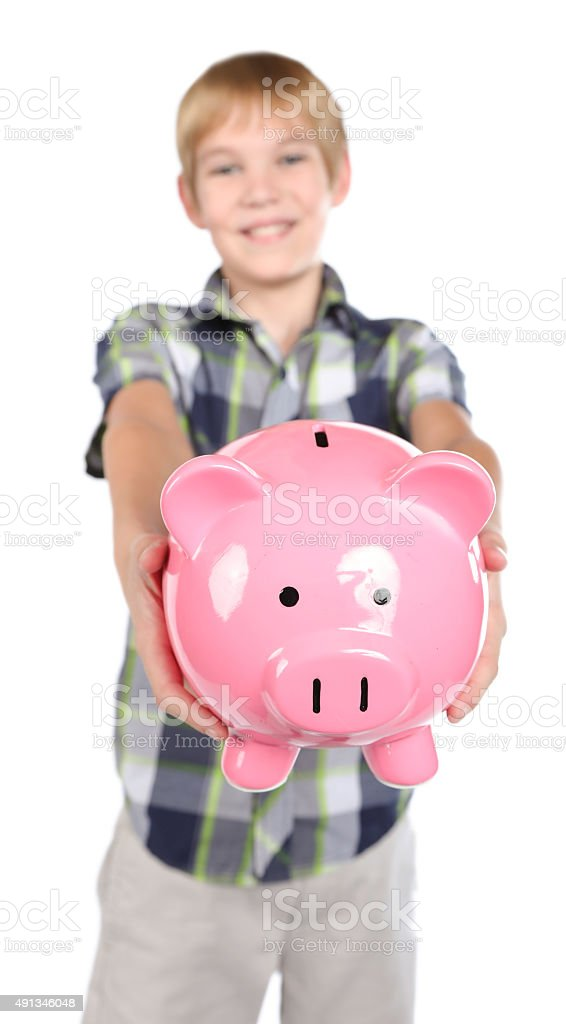 Boy holding pink piggy bank stock photo