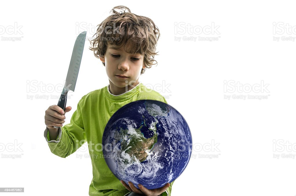Boy holding planet Earth and menacing with knife stock photo