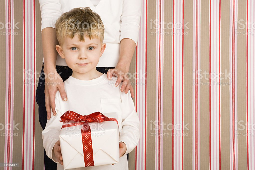 Boy holding present royalty-free stock photo