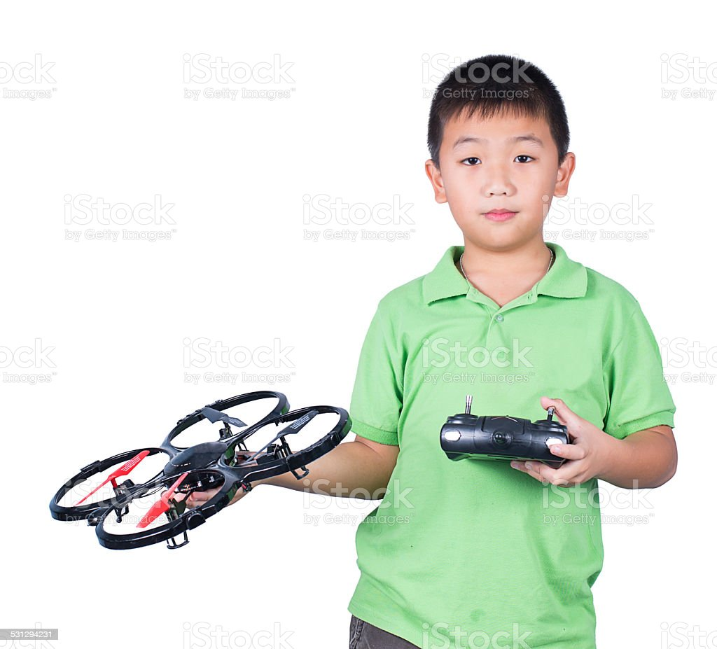 boy holding radio remote control for helicopter, drone, plane stock photo