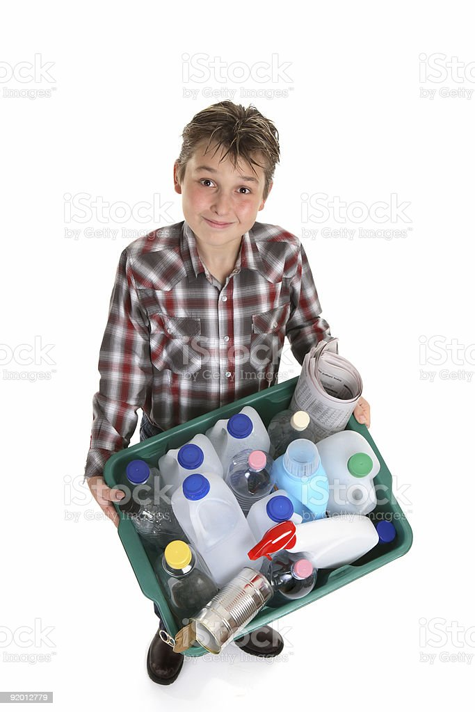 Boy holding recycling container royalty-free stock photo