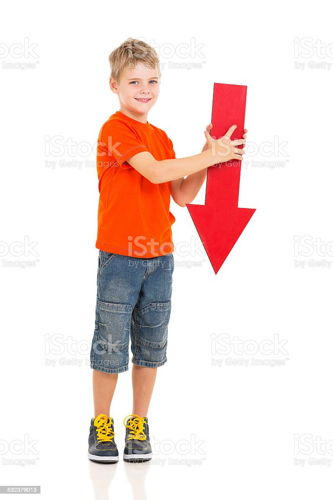 boy holding red arrow pointing down stock photo