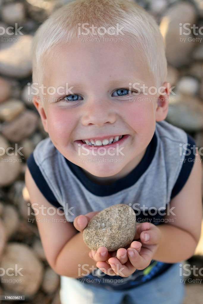 Boy holding rock royalty-free stock photo