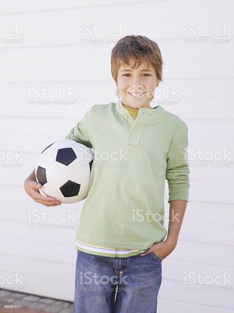 Boy holding soccer ball stock photo
