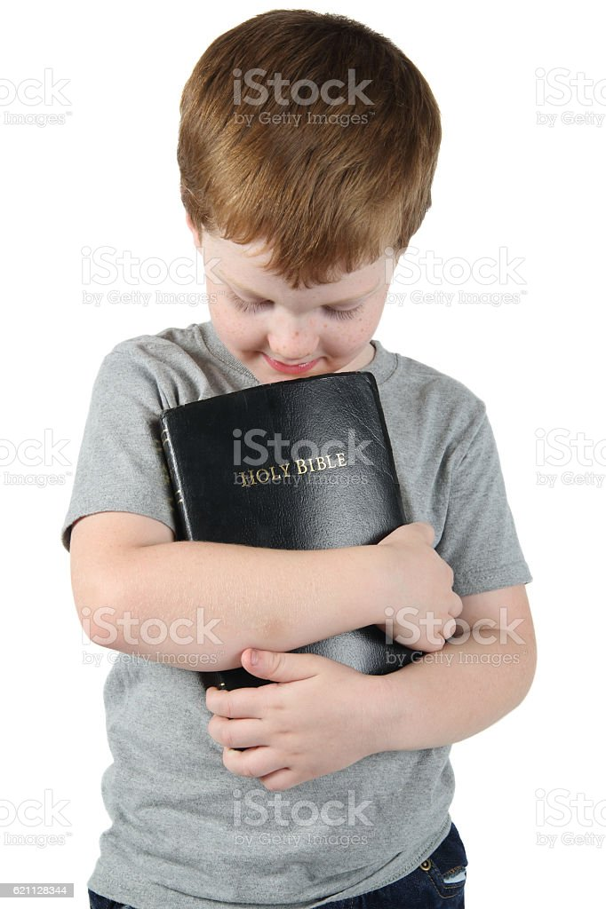 Boy Holding the Bible stock photo