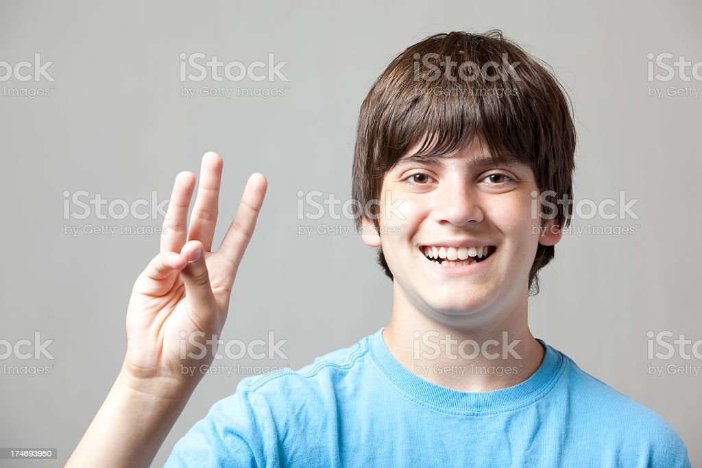 Boy Holds Up Three Fingers stock photo
