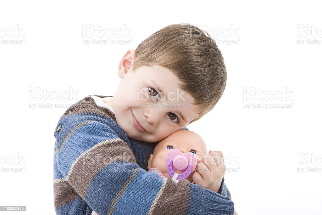 Boy hugging a doll stock photo