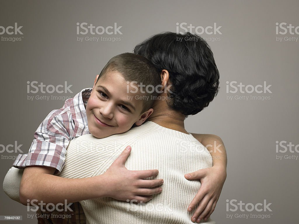 Boy hugging father royalty-free stock photo