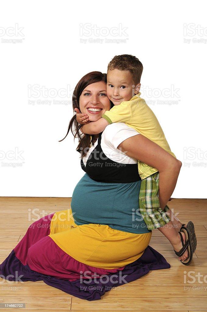 Boy hugging Preg Mom royalty-free stock photo