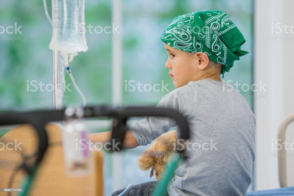 Boy in a Bandana Getting Leukemia Treatment stock photo