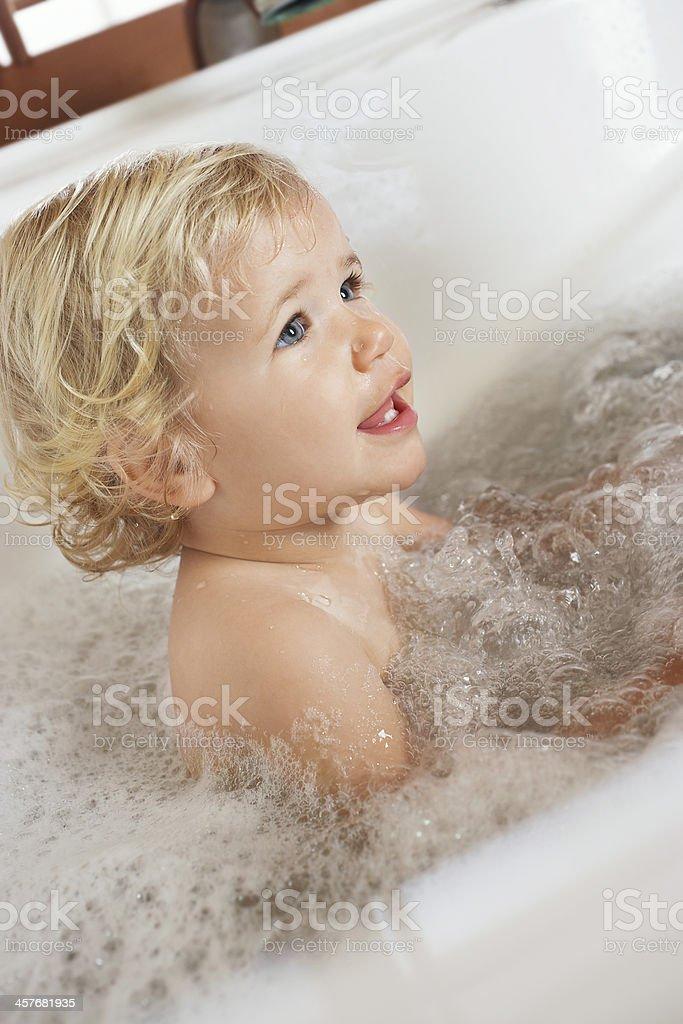 Boy in a Bathtub stock photo