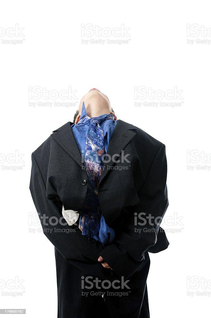Chico en un traje de negocios inclina hacia atrás foto de stock libre de derechos