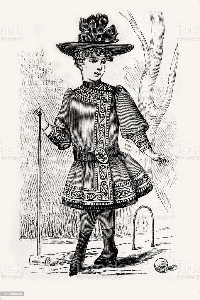 Boy in a dress playing Croquet stock photo