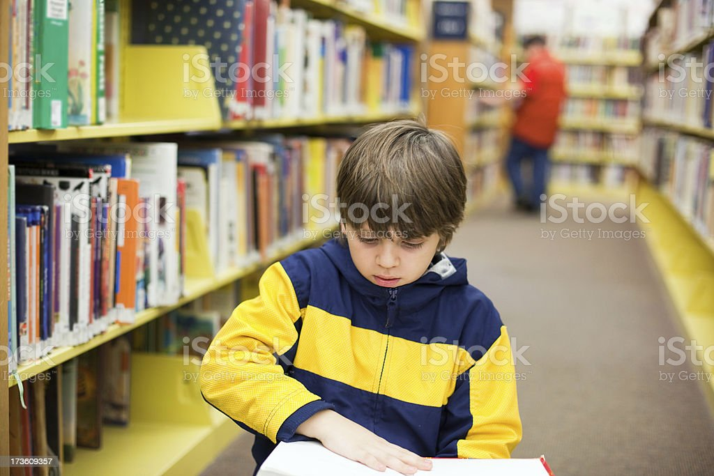 Boy In A Library royalty-free stock photo