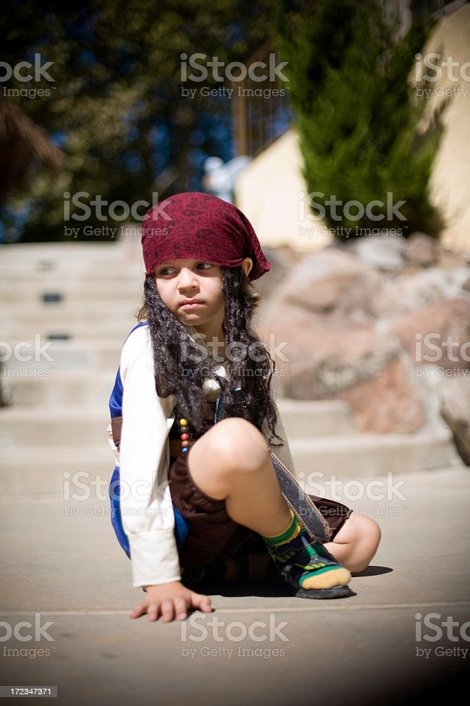 A boy in a pirate costume sitting royalty-free stock photo