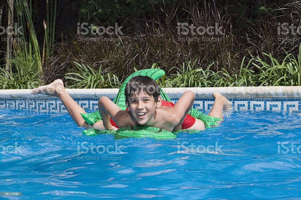 Boy in a swimming pool royalty-free stock photo