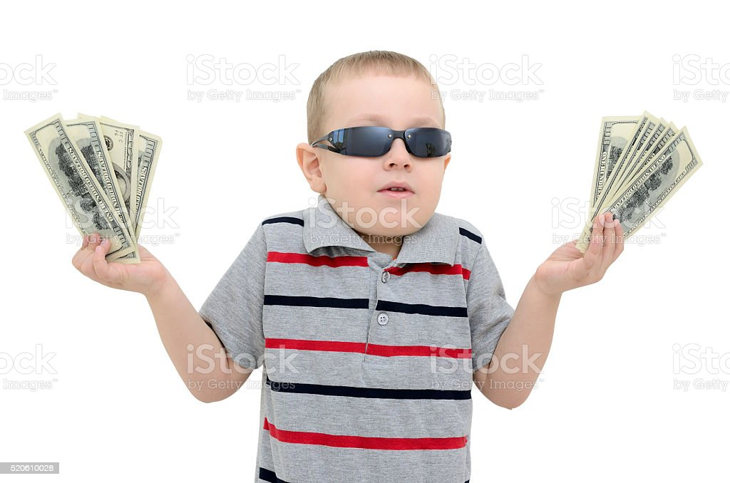 Boy in amazement holding money on white background stock photo