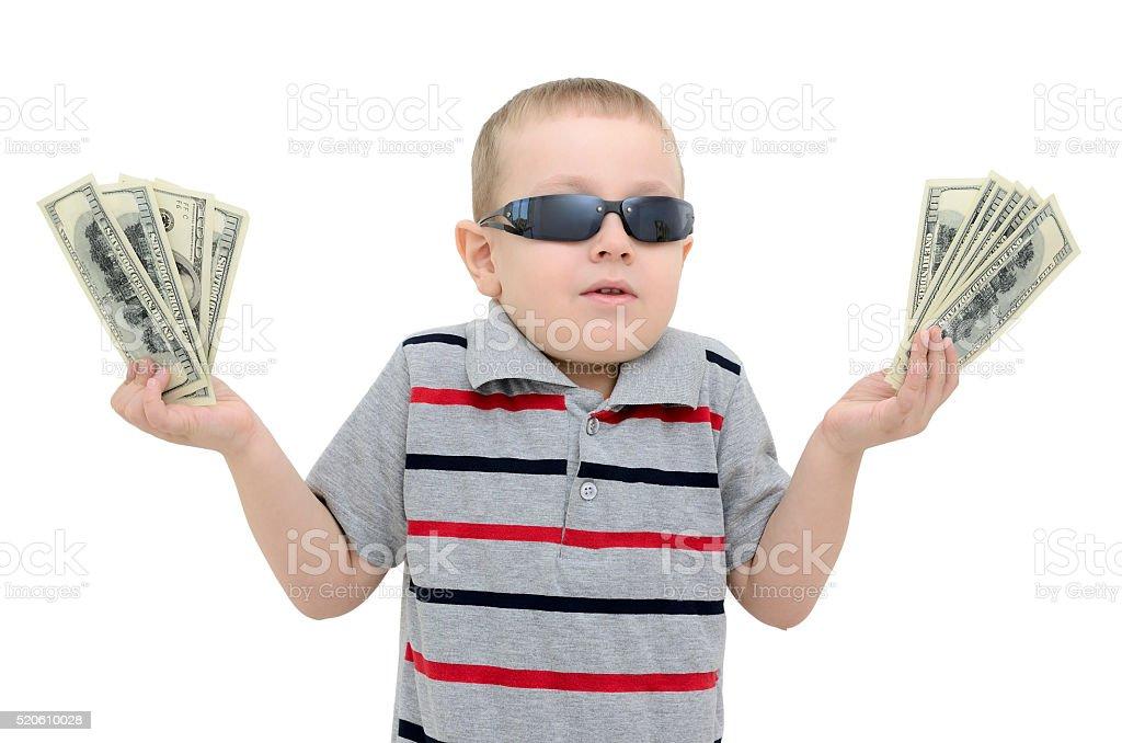 Boy in amazement holding money on white background stock photo