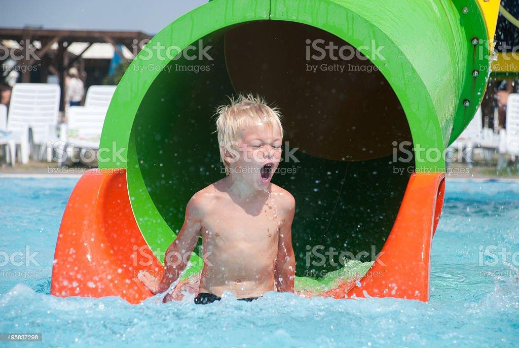 Boy in an aquapark stock photo