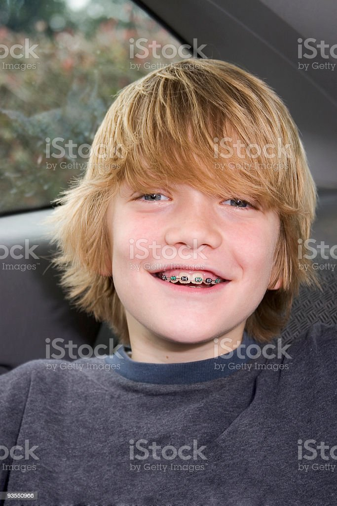 Boy in Back Seat stock photo