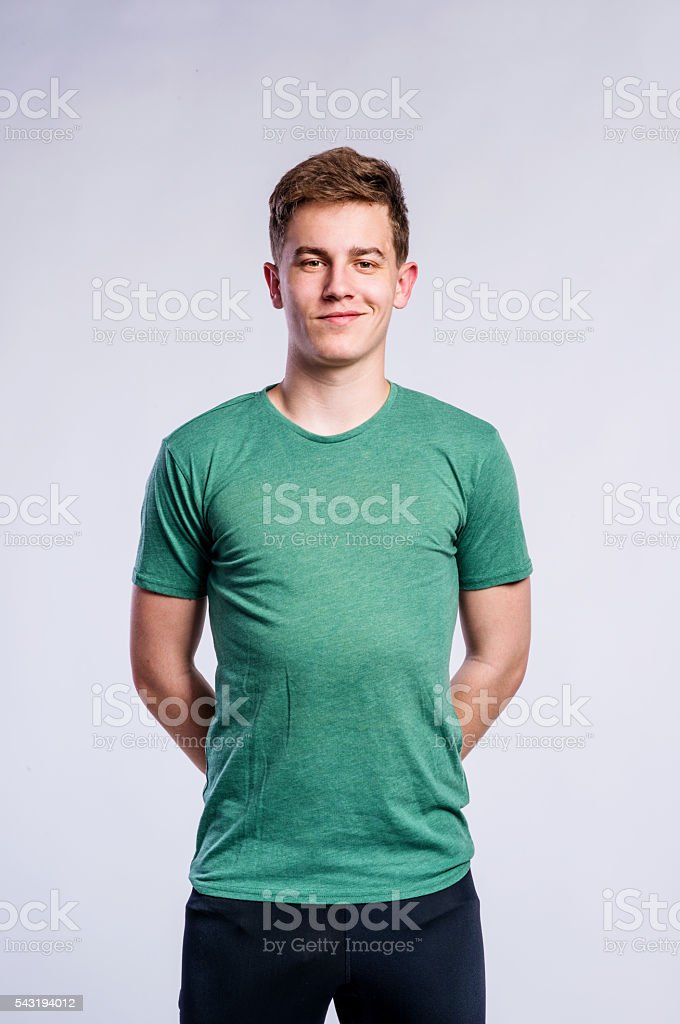 Boy in black sports trousers and t-shirt, studio shot stock photo