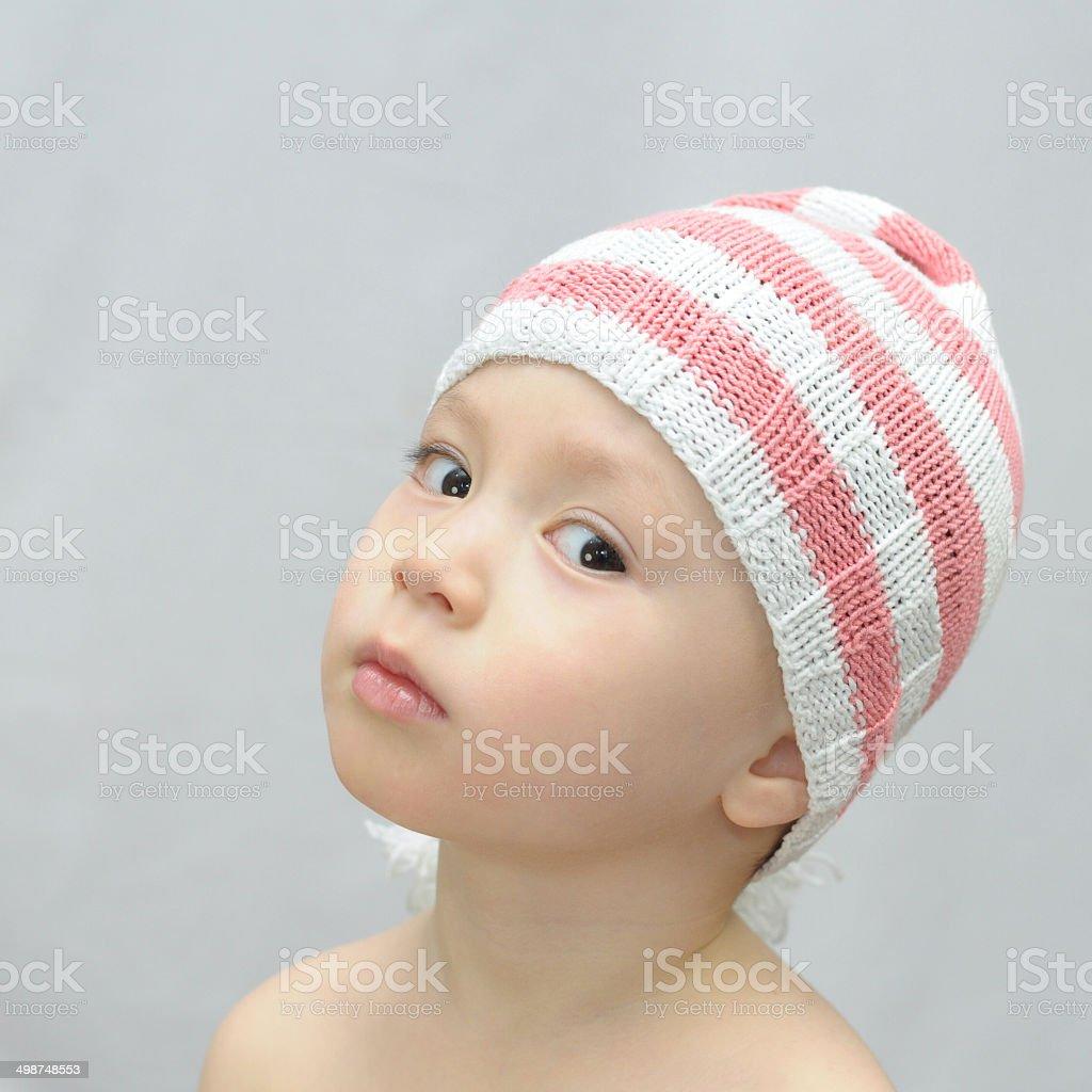 Boy in cap Pinocchio looks akimbo stock photo
