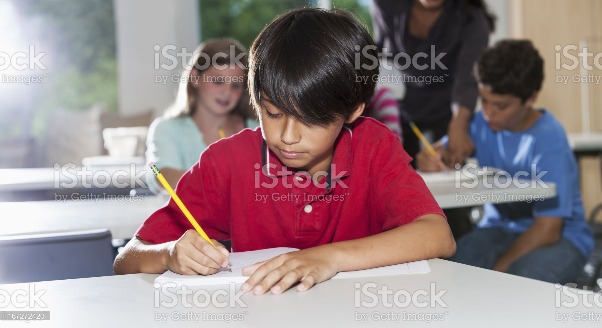 Boy in classroom royalty-free stock photo