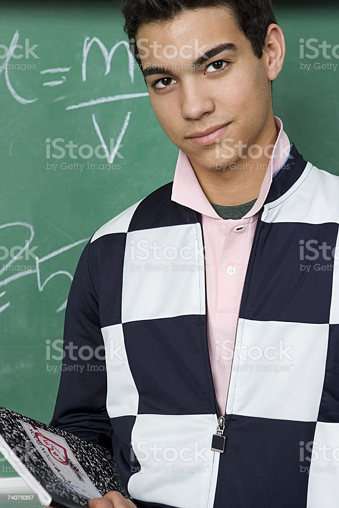 Boy in classroom stock photo