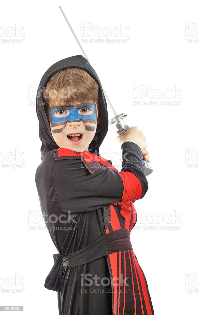 Boy in costume ninja and with a sword stock photo
