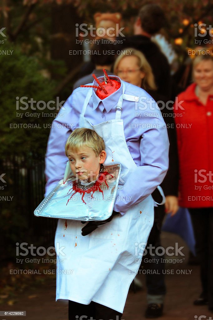 Boy in creative headless costume trick or treats on Halloween stock photo