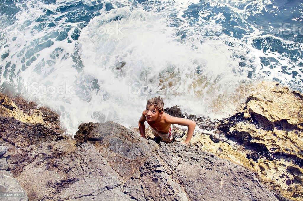 boy in danger seeks help stock photo