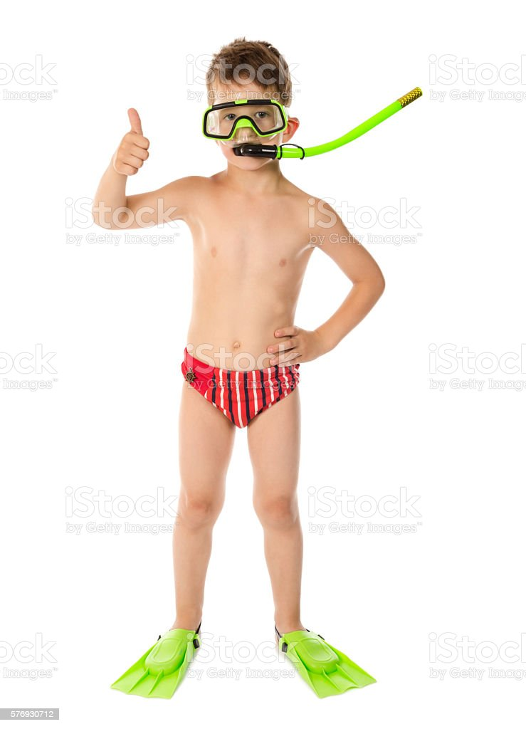 Boy in diving mask with thumb up sign stock photo