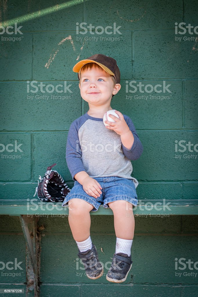 Boy in Dugout stock photo