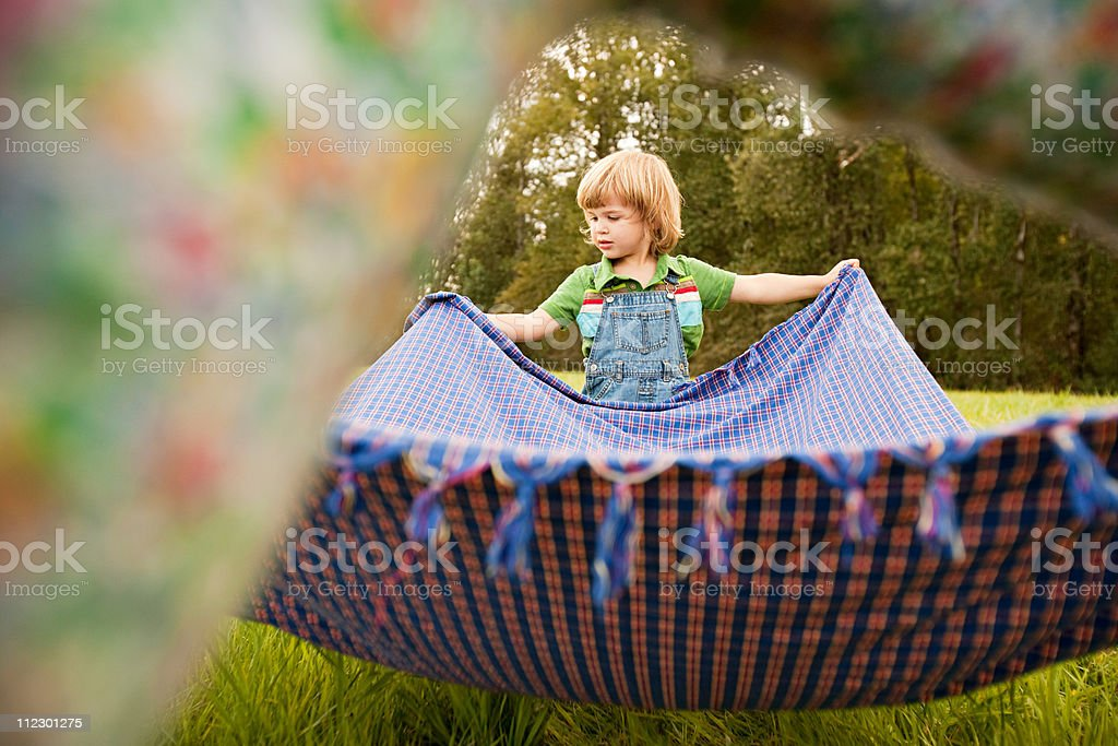 Boy in field with blanket royalty-free stock photo